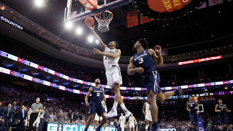 <p>               Villanova's Jermaine Samuels, left, goes up for a shot past Xavier's Quentin Goodin during the second half of an NCAA college basketball game Friday, Jan. 18, 2019, in Philadelphia. Villanova won 85-75. (AP Photo/Matt Slocum)             </p>