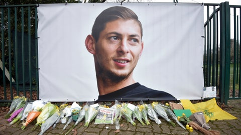 <p>               Flowers and tributes are placed near a giant picture of Argentine soccer player Emiliano Sala outside the FC Nantes training camp, in Nantes, western France, Thursday, Jan. 24, 2019, after a plane with Sala on board went missing over the English Channel on Monday night. Sobbing after the active search for her brother was halted, the sister of Argentine soccer player Emiliano Sala urged authorities Thursday not to give up trying to find the remains of his plane that disappeared from radar over the English Channel. (AP Photo)             </p>