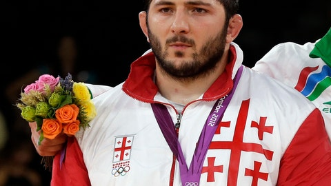 <p>               FILE - In this Saturday, Aug. 11, 2012 file photo, the silver medalist Davit Modzmanashvili of Georgia poses with his medal during the victory ceremony for the men's 120-kg freestyle wrestling competition at the 2012 Summer Olympics in London. The IOC said freestyle wrestler Modzmanashvili is stripped of his 2012 London Olympics silver medal after testing positive for an anabolic steroid. (AP Photo/Paul Sancya, file)             </p>