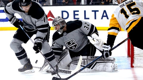 <p>               Los Angeles Kings goalie Jonathan Quick, center, protects the next while defenseman Oscar Fantenberg, left, and Pittsburgh Penguins forward Riley Sheahan try to control the puck during the first period of an NHL hockey game Saturday, Jan. 12, 2019, in Los Angeles. (AP Photo/Ringo H.W. Chiu)             </p>