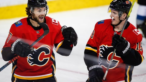 <p>               Calgary Flames' Michael Frolik, left, of the Czech Republic, celebrates his goal against the Colorado Avalanche with Matthew Tkachuk during the third period of an NHL hockey game Wednesday, Jan. 9, 2019, in Calgary, Alberta. (Jeff McIntosh/The Canadian Press via AP)             </p>