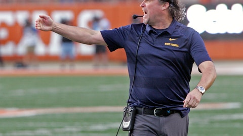 <p>               FILE - In this Nov. 3, 2018, file photo, West Virginia head coach Dana Holgorsen calls out to his team during the second half of an NCAA college football game against Texas, in Austin, Texas. Houston has hired West Virginia's Dana Holgorsen as its coach, Wednesday, Jan. 2, 2019, ending his eight-year run with the Mountaineers. (AP Photo/Michael Thomas, File)             </p>