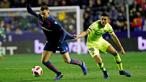<p>               Levante defender Borja Mayora, left, duels for the ball with Barcelona's Chumi during the la Copa del Rey round of 16 first leg soccer match between Levante and Barcelona at the Ciutat de Valencia stadium in Valencia, Spain, Thursday Jan. 10, 2019. (AP Photo/Alberto Saiz)             </p>