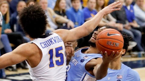 <p>               North Carolina's Coby White, right, tries to get a shot around Pittsburgh's Kene Chukwuka (15) during the second half of an NCAA college basketball game, Saturday, Jan. 5, 2019, in Pittsburgh. North Carolina won 85-60. (AP Photo/Keith Srakocic)             </p>