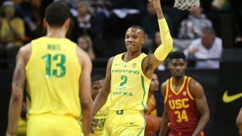 <p>               Oregon's Louis King, center, celebrates against Southern California during the first half of an NCAA college basketball game, Sunday, Jan. 13, 2019, in Eugene, Ore. (AP Photo/Chris Pietsch)             </p>