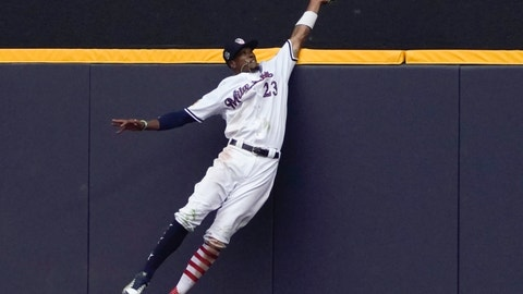 <p>               FILE - In this July 4, 2018, file photo, Milwaukee Brewers' Keon Broxton makes a leaping catch at the wall on a ball hit by Minnesota Twins' Brian Dozier during the ninth inning of a baseball game in Milwaukee. The New York Mets acquired Broxton from the Brewers on Saturday, Jan. 5, 2019, giving them a center field option in addition to Juan Lagares.   (AP Photo/Morry Gash, File)             </p>