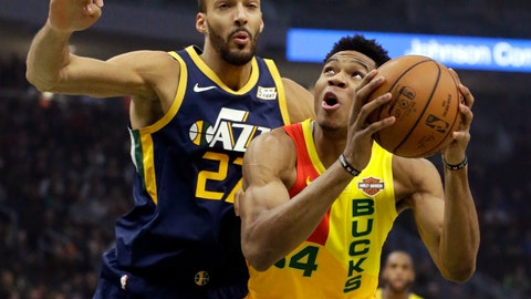 <p>               Milwaukee Bucks' Giannis Antetokounmpo, right, shoots past Utah Jazz's Rudy Gobert during the first half of an NBA basketball game Monday, Jan. 7, 2019, in Milwaukee. (AP Photo/Aaron Gash)             </p>