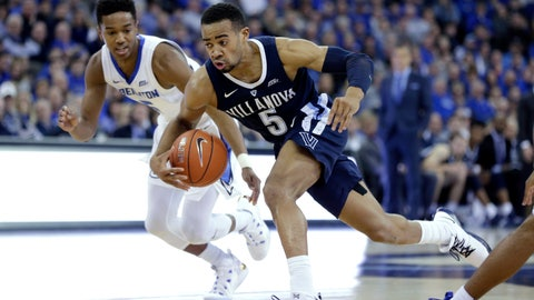 <p>               Villanova's Phil Booth (5) drives to the basket against Creighton's Ty-ShonAlexander, left, during the first half of an NCAA college basketball game in Omaha, Neb., Sunday, Jan. 13, 2019. (AP Photo/Nati Harnik)             </p>