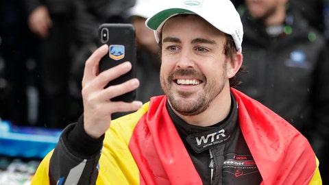 <p>               Fernando Alonso, of Spain, takes a selfie photo in Victory Lane after winning the IMSA 24 hour race at Daytona International Speedway, Sunday, Jan. 27, 2019, in Daytona Beach, Fla. (AP Photo/John Raoux)             </p>