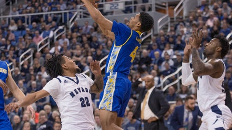 <p>               Nevada guard Jazz Johnson (22) and San Jose State guard Zach Chappell (4) go after a loose ball during the first half of an NCAA college basketball game in Reno, Nev., Wednesday, Jan. 9, 2019. (AP Photo/Tom R. Smedes)             </p>