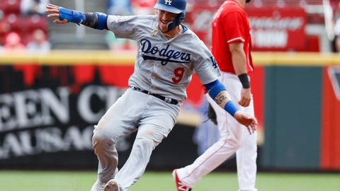 <p>               FILE - In this Sept. 12, 2018, file photo, Los Angeles Dodgers' Yasmani Grandal advances to second on an error by Cincinnati Reds second baseman Scooter Gennett during a baseball game in Cincinnati. A person familiar with the negotiations tells The Associated Press that Grandal and the Milwaukee Brewers have agreed to a one-year contract. The person spoke on condition of anonymity Wednesday, Jan. 9, because the agreement, first reported by The Athletic, was subject to a successful physical. (AP Photo/John Minchillo, File)             </p>