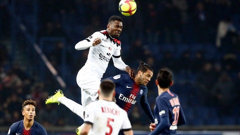<p>               FILE  - In this Sunday, Jan. 19, 2019 file photo, Guingamp's Marcus Thuram, top, jumps for the ball with PSG's Dani Alves during the League One soccer match between Paris Saint Germain and Guingamp at the Parc des Princes stadium in Paris. When Guingamp forward Marcus Thuram left the Parc des Princes stadium last weekend, he took an important souvenir away with him. Thuram carried a crumpled fluorescent yellow jersey in his hands, given to him by PSG's veteran goalkeeper Gianluigi Buffon after the game.  (AP Photo/Michel Euler, File)             </p>