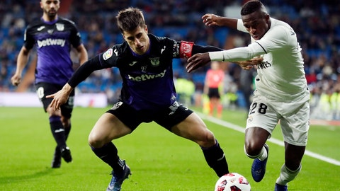 <p>               Real Madrid's Vinicius Jr, right, duels for the ball with Leganes' Unai Bustinza during a Spanish Copa del Rey soccer match between Real Madrid and Leganes at the Bernabeu stadium in Madrid, Spain, Wednesday, Jan. 9, 2019. (AP Photo/Manu Fernandez)             </p>