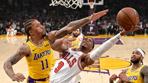 <p>               Chicago Bulls guard Shaquille Harrison, center, shoots as Los Angeles Lakers forward Michael Beasley, left, defends along with forward Brandon Ingram during the first half of an NBA basketball game Tuesday, Jan. 15, 2019, in Los Angeles. (AP Photo/Mark J. Terrill)             </p>