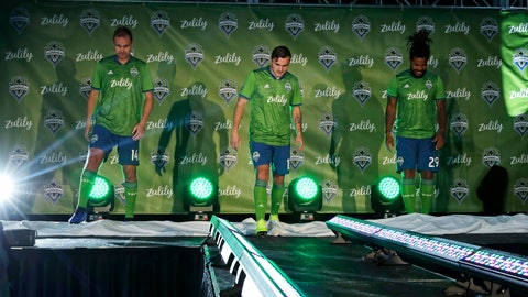 <p>               Seattle Sounders' Chad Marshall, left, Jordan Morris, center, and Roman Torres, right, model new MLS soccer jerseys, Thursday, Jan. 17, 2019, during an event to unveil the Sounders' new jersey sponsorship with Zulily, a Seattle-based online clothing retailer. Zulily also announced a jersey sponsorship with the Seattle Reign in the National Women's Soccer League. (AP Photo/Ted S. Warren)             </p>