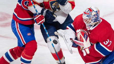 <p>               Florida Panthers center Aleksander Barkov (16) is sandwiched between Montreal Canadiens defenseman Victor Mete (53) and Montreal Canadiens goaltender Antti Niemi (37) during the first period of an NHL hockey game, Tuesday, Jan. 15, 2019 in Montreal. (Ryan Remiorz/The Canadian Press via AP)             </p>