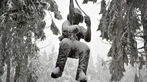 <p>               A promotion doll covered with ice and snow hangs between trees near a climbing park at the Wasserkuppe, Germany, Friday, Jan 11, 2019.  (Uwe Zucchi/dpa via AP)             </p>