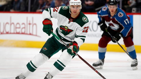 <p>               FILE - In this Friday, March 2, 2018, file photo, Minnesota Wild right wing Nino Niederreiter (22) picks up the puck as Colorado Avalanche center Tyson Jost drops back to defend in the first period of an NHL hockey game in Denver. The Minnesota Wild have acquired center Victor Rask from the Carolina Hurricanes for left wing Nino Niederreiter, in a swap of underperforming but still-young players on long-term contracts. (AP Photo/David Zalubowski, File)             </p>