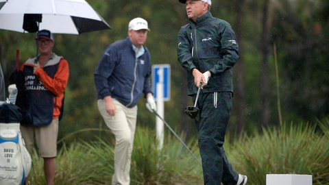 <p>               FILE - In this Dec. 15, 2018, file photo, Dru Love, center, watches as his father, Davis Love III, right, tees off on the second hole during the first round of the Father Son Challenge golf tournament, in Orlando, Fla. The Loves are playing in Singapore this week, the 14th time they played in the same event. (AP Photo/Phelan M. Ebenhack, File)             </p>
