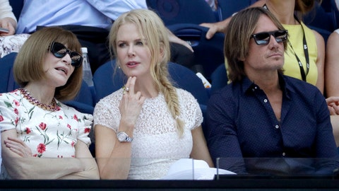 <p>               Australian actor Nicole Kidman, center, sits with her husband Keith Urban, right, as she chats with Anna Wintour, ahead of the semifinal between Petra Kvitova of the Czech Republic and United States' Danielle Collins at the Australian Open tennis championships in Melbourne, Australia, Thursday, Jan. 24, 2019.             </p>