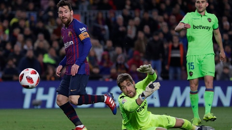 <p>               FC Barcelona's Lionel Messi, center, kicks the ball to score his side's third goal during a Spanish Copa del Rey soccer match between FC Barcelona and Levante at the Camp Nou stadium in Barcelona, Spain, Thursday, Jan. 17, 2019. (AP Photo/Manu Fernandez)             </p>