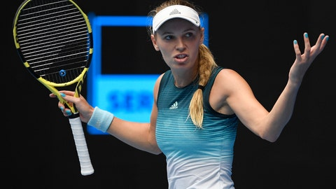 <p>               Denmark's Caroline Wozniacki gestures during her second round match against Sweden's Johanna Larsson at the Australian Open tennis championships in Melbourne, Australia, Wednesday, Jan. 16, 2019. (AP Photo/Andy Brownbill)             </p>