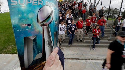 <p>               FILE - In this Feb. 5, 2017, file photo, a sales person holds up a program as fans arrive at NRG Stadium before NFL football's Super Bowl 51 between the Atlanta Falcons and the New England Patriots in Houston. of you're headed to the Super Bowl some year in the future, and you're wondering how much cash you'll need for the big game. No worries: During its sponsorship renewal with the NFL through the 2025 season, Visa envisions the first cashless Super Bowl. (AP Photo/David J. Phillip, File)             </p>