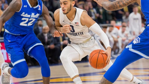<p>               Marquette guard Markus Howard, right, drives to the basket against Seton Hall guard Myles Cale, left, during the first half of an NCAA college basketball game Saturday, Jan. 12, 2019, in Milwaukee. (AP Photo/Darren Hauck)             </p>
