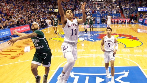 <p>               Kansas' Devon Dotson (11) gets past Eastern Michigan's Malik Ellison (10) to put up a shot during the first half of an NCAA college basketball game Saturday, Dec. 29, 2018, in Lawrence, Kan. (AP Photo/Charlie Riedel)             </p>