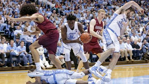 <p>               North Carolina's Nassir Little (5) grabs the ball while Kenny Williams falls and tangles with Luke Maye (32) during a play against Harvard's Mason Forbes and Henry Welsh (44) during the second half of an NCAA college basketball game in Chapel Hill, N.C., Wednesday, Jan. 2, 2019. (AP Photo/Gerry Broome)             </p>