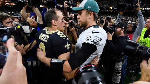 <p>               New Orleans Saints quarterback Drew Brees (9) speaks with Philadelphia Eagles quarterback Nick Foles after an NFL divisional playoff football game in New Orleans, Sunday, Jan. 13, 2019. The Saints won 20-14 to advance to the NFC Championship. (AP Photo/Bill Feig)             </p>