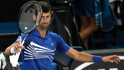 <p>               Serbia's Novak Djokovic waves to the crowd after Japan's Kei Nishikori retired injured from their quarterfinal at the Australian Open tennis championships in Melbourne, Australia, Wednesday, Jan. 23, 2019. (AP Photo/Kin Cheung)             </p>