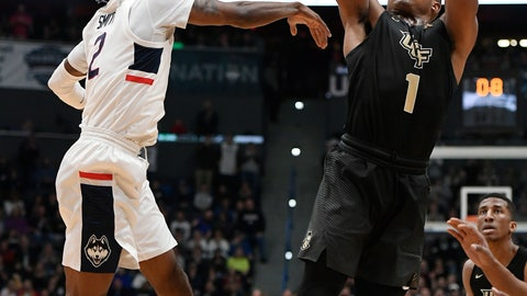 <p>               CORRECTS DATE - Central Florida's BJ Taylor shoots a basket over Connecticut's Tarin Smith, left, during the first half of an NCAA college basketball game, Saturday, Jan. 5, 2019, in Hartford, Conn. (AP Photo/Jessica Hill)             </p>