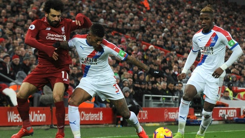 <p>               Liverpool's Mohamed Salah, left, and Crystal Palace's Patrick van Aanholt challenge for the ball during the English Premier League soccer match between Liverpool and Crystal Palace at Anfield in Liverpool, England, Saturday, Jan. 19, 2019. (AP Photo/Rui Vieira)             </p>