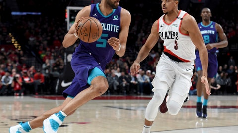 <p>               Charlotte Hornets forward Nicolas Batum, left, drives to the basket on Portland Trail Blazers guard CJ McCollum, right, during the first half of an NBA basketball game in Portland, Ore., Friday, Jan. 11, 2019. (AP Photo/Steve Dykes)             </p>
