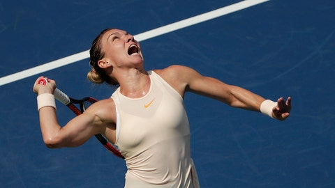<p>               FILE - In this Aug. 27, 2018, file photo, Simona Halep, of Romania, serves to Kaia Kanepi, of Estonia, during the first round of the U.S. Open tennis tournament, in New York.  No. 1-ranked Halep returns to competitive tennis this week at the Sydney International unsure if her back injury has fully healed.(AP Photo/Andres Kudacki, File)             </p>