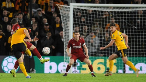 <p>               Wolverhampton's Ruben Neves, left, scores his sides second goal during the English FA Cup third round soccer match between Wolverhampton Wanderers and Liverpool at the Molineux Stadium in Wolverhampton, England, Monday, Jan. 7, 2019. (AP Photo/Rui Vieira)             </p>