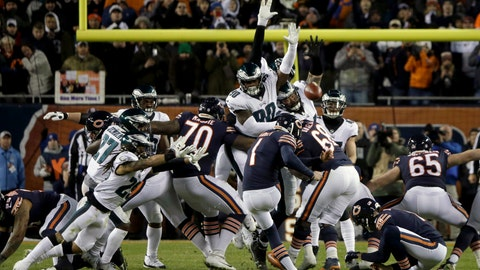 <p>               FILE- In this Jan. 6, 2019, file photo, Chicago Bears kicker Cody Parkey (1) boots a field goal-attempt during the second half of an NFL wild-card playoff football game against the Philadelphia Eagles in Chicago. Eagles' Treyvon Hester (90) tipped Parkey's attempt just enough to send the ball bouncing off the upright and crossbar, securing a 16-15 win at Chicago in the wild-card round. (AP Photo/David Banks, File)             </p>