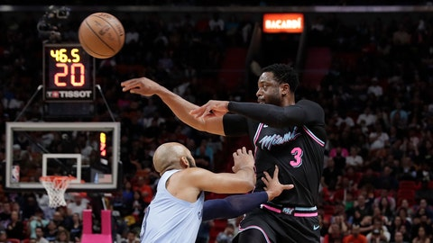 <p>               Miami Heat guard Dwyane Wade (3) passes the ball against Memphis Grizzlies guard Jevon Carter in the second half of an NBA basketball game Saturday, Jan. 12, 2019, in Miami. (AP Photo/Brynn Anderson)             </p>