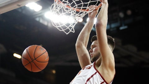 <p>               Southern California's Nick Rakocevic dunks during the first half of the team's NCAA college basketball game against Arizona, Thursday, Jan. 24, 2019, in Los Angeles. (AP Photo/Jae C. Hong)             </p>