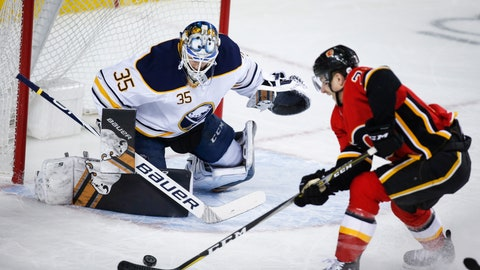 <p>               Buffalo Sabres goalie Linus Ullmark, left, of Sweden, guards the net as Calgary Flames' Garnet Hathaway tries to score on a breakaway during the first period of an NHL hockey game, Wednesday, Jan. 16, 2019, in Calgary, Alberta. (Jeff McIntosh/The Canadian Press via AP)             </p>