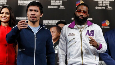 <p>               Manny Pacquiao, left, and Adrien Broner pose for photographers during a news conference Wednesday, Jan. 16, 2019, in Las Vegas. The two are scheduled to fight in a welterweight championship bout on Saturday. (AP Photo/John Locher)             </p>