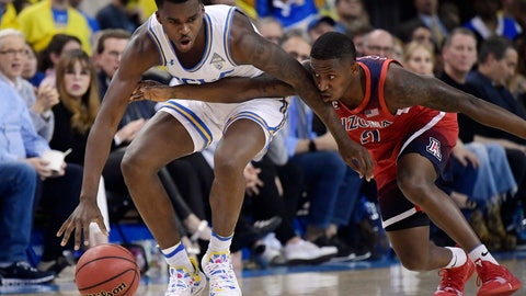 <p>               Arizona guard Justin Coleman, right, reaches for the ball against UCLA guard Kris Wilkes during the first half of an NCAA college basketball game Saturday, Jan. 26, 2019, in Los Angeles. (AP Photo/Mark J. Terrill)             </p>