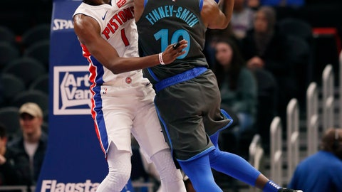 <p>               Dallas Mavericks forward Dorian Finney-Smith (10) shoots as Detroit Pistons guard Reggie Jackson (1) defends during the first half of an NBA basketball game Thursday, Jan. 31, 2019, in Detroit. (AP Photo/Carlos Osorio)             </p>