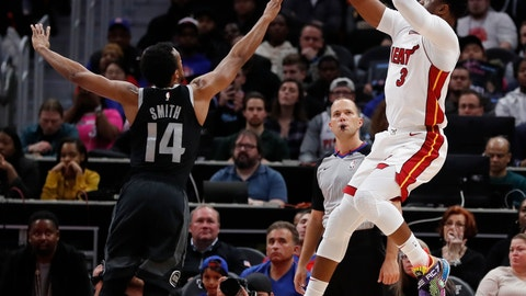 <p>               Miami Heat guard Dwyane Wade (3) shoots as Detroit Pistons guard Ish Smith (14) defends during the first half of an NBA basketball game, Friday, Jan. 18, 2019, in Detroit. (AP Photo/Carlos Osorio)             </p>