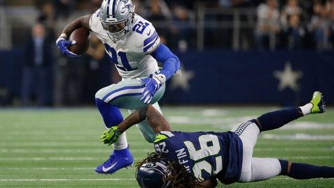 <p>               Dallas Cowboys running back Ezekiel Elliott (21) runs near Seattle Seahawks cornerback Shaquill Griffin (26) during the second half of the NFC wild-card NFL football game in Arlington, Texas, Saturday, Jan. 5, 2019. (AP Photo/Ron Jenkins)             </p>