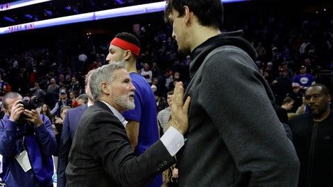 <p>               Philadelphia 76ers head coach Brett Brown, left, greets Minnesota Timberwolves' Dario Saric after an NBA basketball game, Tuesday, Jan. 15, 2019, in Philadelphia. Philadelphia won 149-107. (AP Photo/Matt Slocum)             </p>