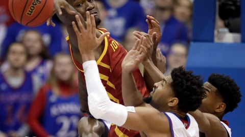 <p>               Iowa State forward Cameron Lard, left, tries to rebound over Kansas forward Dedric Lawson (1) and guard Ochai Agbaji, right, during the first half of an NCAA college basketball game in Lawrence, Kan., Monday, Jan. 21, 2019. (AP Photo/Orlin Wagner)             </p>