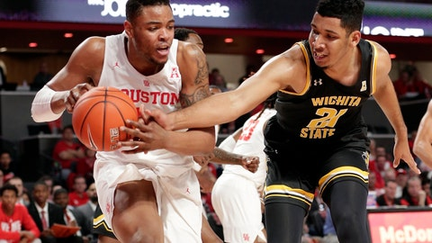 <p>               Houston forward Breaon Brady (24) gets a rebound as Wichita State forward Jaime Echenique (21) reaches in during the first half of an NCAA college basketball game Saturday, Jan. 12, 2019, in Houston. (AP Photo/Michael Wyke)             </p>