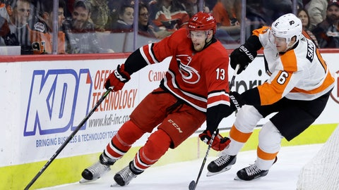 <p>               Carolina Hurricanes' Warren Foegele, left, and Philadelphia Flyers' Travis Sanheim race for the puck during the first period of an NHL hockey game Thursday, Jan. 3, 2019, in Philadelphia. (AP Photo/Matt Slocum)             </p>